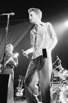 Ricky Wilson and Fred Schneider of rock band The B52s live at The Lyceum in London 1979