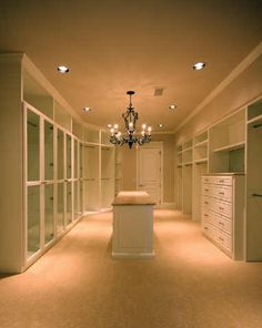 Dream closet!  Except rather than an island I want a tower that hold all my jewelry including hanging my necklaces. :-)