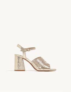 Golden sandals.