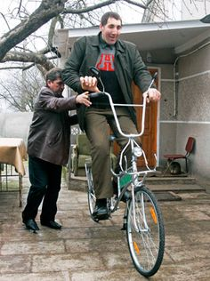 Ukrainian Leonid Stadnyk rides a new bicycle specially made for him in the village of Podolyantsi in Ukraine's Zhytomyr region, about 124 miles from the capital, Kiev, March 23, 2008. Standing at 8 feet 4 inches, Stadnyk is the world's tallest man according to the Guinness World Records. (Reuters)