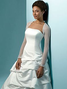 sheer wedding dress- minus the sleeves, this would be a MUST try on dress!