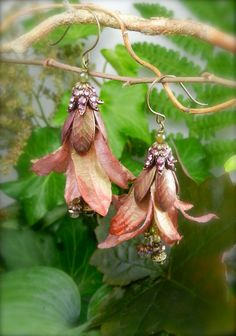 RASPBERRY FIZZ--Floral fiber earrings, in glimmering shades of coral, raspberry and pearly cranberry.. $38.50, via Etsy.
