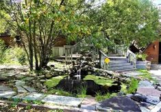 Small pond, water cascade, stairs, trees, stone garden,  geodesic eco dome, water cascade, stream flow, house for sale,, 9121 CR 23 Brainerd MN 56401 Geodesic Dome Homes, Long Lake, Gallon Of Water, Dome House, Small Ponds, Safe Haven, Water Conservation, Garden Stones, Solar Panels