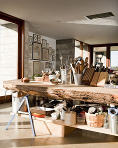 Kitchen island made from the cross-section of an enormous cypress tree. Nice place to chop veggies :)