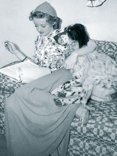 Miss Bette Davis and her English Setter reading a script. In 1976 she autographed my copies of her 2 biographies.: