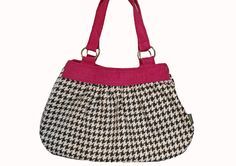 Handmade purse - lare shoulder bag in classic black and white houndstooth with magenta accents. $74.99, via Etsy.