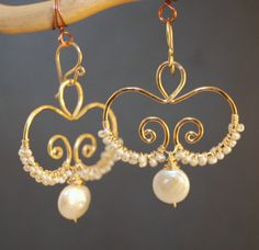 Hammered swirls with ivory pearls wrapped around, about 1-1/2 long   Available in 14k gold filled & sterling silver 14k rose gold filled