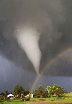 A rainbow below a twister in Kansas ... God's promise that there will never ever be another great flood.