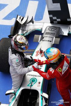 Race winner Lewis Hamilton, Mercedes AMG F1 W05 celebrates in parc ferme with Fernando Alonso, Ferrari