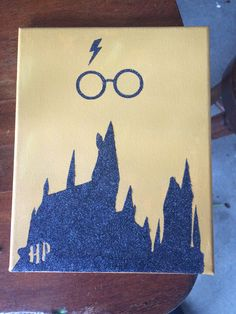 Harry Potter canvas  Hogwarts school in glitter on a yellow painted canvas_byAshleyBerrios