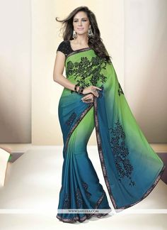 Ravishing attire to enhance your beauty. Make an adorable statement in this smashy multi colour georgette and satin designer saree. The embroidered and patch border work looks chic and perfect for any...