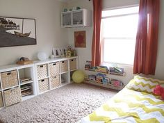 very nice book storage that is low down so accessable for kids - made from ikea spice racks!