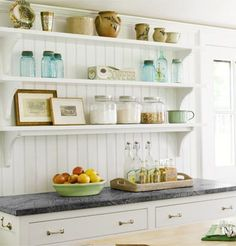 How open shelving can give your kitchen a contemporary look while easily saving you half the price of installing cabinets with doors.