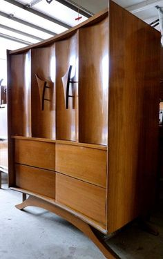 mid century modern highboy -- The door pulls are fantastic, and the curve of the wood is amazing. I've never seen anything like this.
