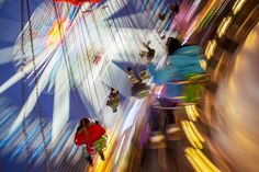 Children ride on a merry-go-round at a Christmas market in Berlin Photograph: Hannibal Hanschke/Reuters