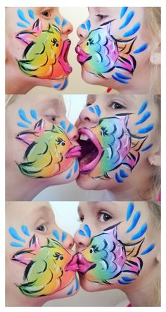 Sisters with Fish Face Paint. Growling, kissing and giggling!