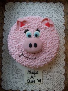 """Pig Cake - This cake was made of a Pork BBQ - choclate cake in a 10"""" round pan. Nose is a cake cut out, covered in pink fondant. Fondant ears and eyes. Buttercream frosting for the rest of the cake!"""