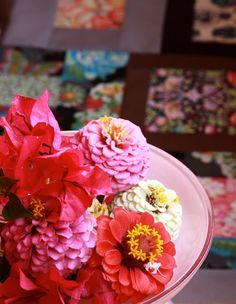 dahlias and other flowers in a pile on plates