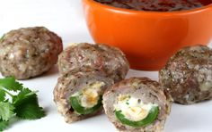 Armadillo Eggs...cheese and jalapeño stuffed sausage balls. Perfect football food!