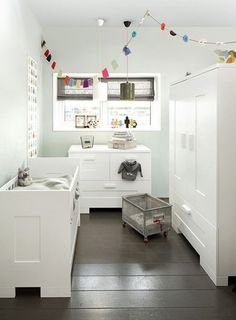 grey and white nursery with a pop of color