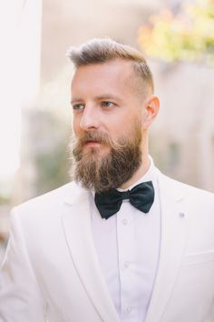 A white tux: http://www.stylemepretty.com/destination-weddings/2016/06/24/an-inspo-complete-with-an-off-the-rack-wedding-gown-you-need-to-own/ | Photography: Nastja Kovacec Photography - http://www.nastjakovacec.com/