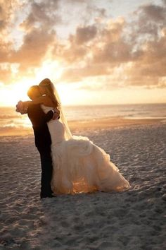 This #beach #wedding picture is just perfect!  So romantic! www.CharmingGraceEvents.com