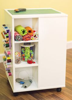 """Like this idea for a moveable island for storage or cutting/ironing.  This is from Joann's and is 20x20 and 30"""" high.  But, it's $99 on sale and doesn't maximize the storage for my needs. Either make something similar from a repurposed cabinet, or use the white cubes."""