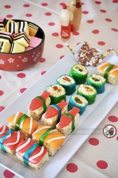 Dessert Sushi! Ingredients: LCM bars/Rice Krispies bar for the rice Air Heads, either the short ones or long ones, in orange, pink (or red), and white - sashimi blue and green Fruit Roll-Ups - for the nori Swedish Fish - for the sashimi Gummy worms/snakes - for the filling. ALL CREDIT GOES TO SWEETEST KITCHEN