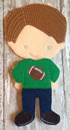 Items similar to After The Big Game: Felt Doll Football Outfit on Etsy Felt Kids, Paper Dolls Book, Football Outfits, Doll Quilt, Toy Craft, Boy Doll, Toddler Gifts, Felt Dolls, Infant Activities