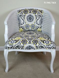 Immaculate finish on this white painted cane barrel chair.  Crisp paisely fabric in grey, white, and yellow.  Fine attention to detail in every way!  #flyingtack #paisley #canechair