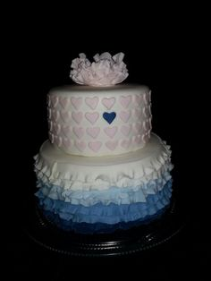 Fondant covered cakes with fondant ruffles and heart cut outs.... gum paste peony