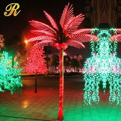 Using an LED rope lighted palm tree indoors with a red and green color scheme - a great way to do alternative decorating at a Christmas party or wedding.