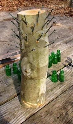 It used to be that you could see bottle trees scattered all over the Southern landscape. Usually in the country or along the bayous of Louisiana, Mississippi, Tennesee, and Alabama, bottle trees are a colorful folk tradition with the purpose of. Wine Bottle Trees, Wine Bottle Art, Blue Bottle, Wine Bottle Crafts, Glass Bottle, Wine Bottles, Wine Bottle Garden, Outdoor Crafts, Outdoor Art