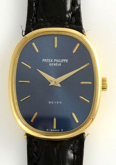 ... watch by Patek Philippe in 18 karat yellow gold case with original blue  dial, circa This Ellipse Golden model is in mint condition, 18 jewel  movement, ... 822a2422446