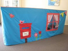 Table tent. Put a mailbox in, so you can write letters to the kids.