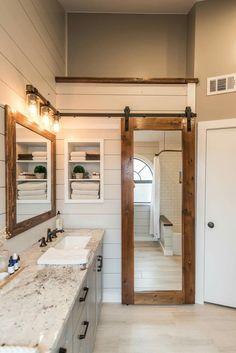 Full length mirror on inside of barn sliding door in bathroom