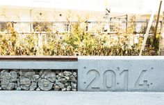 KOSHA HEIM CHITOSE KARASUYAMA Concrete Bench   Gabion wall
