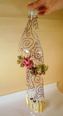 recycle a soda or water bottle into an earring holder! smart and easy...