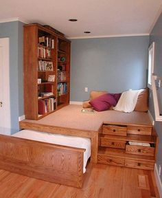 I love space saving ideas. I think this is fantastic! Guest room and library in one! Or, for a small kids room, bed and study area in one.