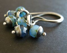 teal blue glass beads and sterling silver by archaicdesign on Etsy, $25.00. I like the caps.