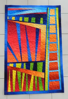 Sunset in the City an abstract quilted by Quiltsbysuewaldrep, $120.00
