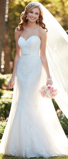 This strapless wedding dress by Stella York features french tulle gathered at the sweetheart neckline revealing a slice of romantic lace with Diamante beading. The A-line gown zips up under fabric-covered buttons.
