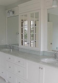Mirrored door center cabinet, twin bowl marble top, white paneled vanity, chrome trim & fixtures - classic simplicity.