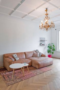 chandelier and a leather sofa