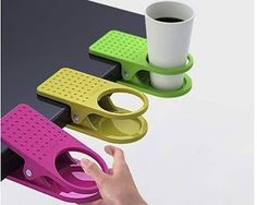 DESK CUP HOLDER: A smart extension for your space. The DrinKlip attaches to any desk, tabletop or shelf. Holds your drink, phone or other small items. Measures 4 by 8 by 2.5-inches. Assorted black, blue, red and white colors.  Buy from Amazon  $12