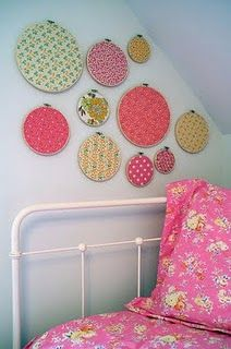 girly pic....but suuuuper good idea to decorate with fabric covered embroidery hoops.