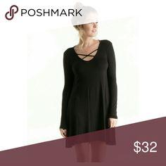 🎉Party Sale🎉  Beautiful Crisscross Swing Dress Beautiful Crisscross Swing Dress.  Super comfortable & edgy too!  95% Rayon 5% Spandex. Skirts