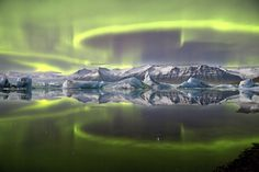 This overall winning photo shows a green aurora above a glacial lagoon in Iceland.