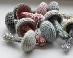 Crochet mushroom pin with light grey stem and pale salmon pink cap. Mushroom is made of cotton and linen thread. Bottom of the stem is embellished with glass beads. Theres pin back attached to the back of the mushroom cap. This whimsical woodland brooch is just a perfect accessory to