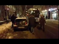 The tram got stuck in snow - look what the by passers did